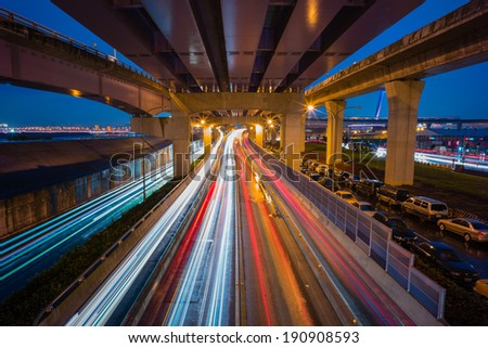 traffic trails on the highway - stock photo