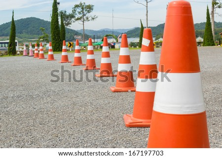 traffic warning cone in row to separate route in parking area - stock photo