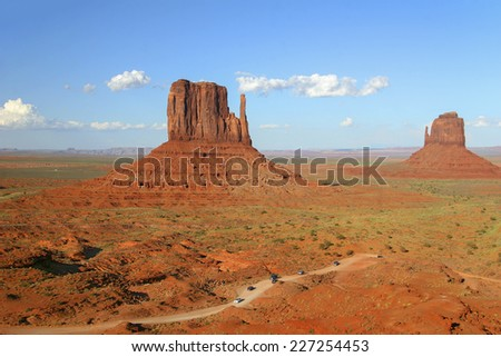 "Traffic Winding Through Monument Valley with Left and Right Mitten Rock Formations in the ""Background - Arizona - stock photo"