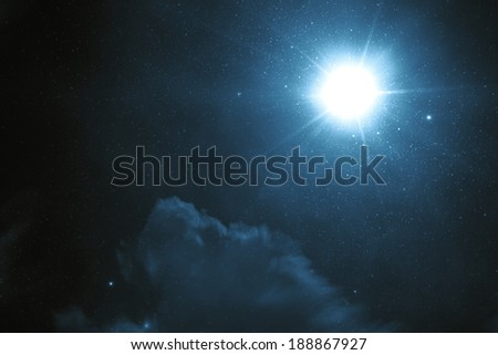 Tragic night sky with a full moon and shining stars - stock photo