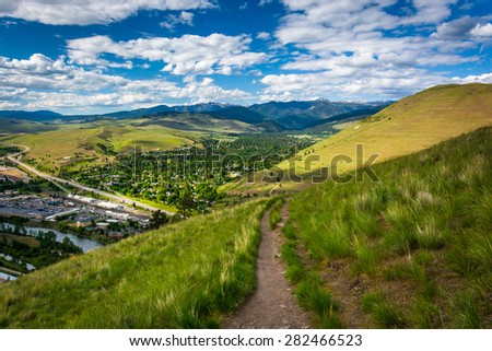 Trail and view of Missoula from Mount Sentinel, in Missoula, Montana. - stock photo