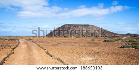 Trail and volcano La Caldera on the small island of Los Lobos, near Fuerteventura, in the Canary Islands, Spain. - stock photo