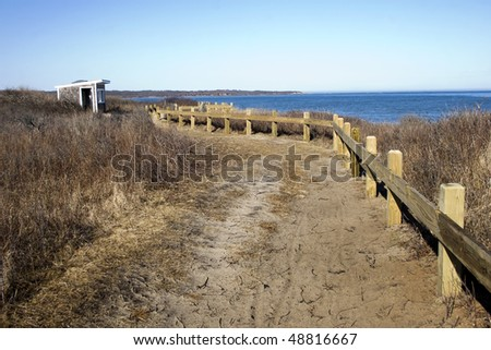 Trail leading to the observation hut overlooking the Atlantic ocean at Montauk Point, Long Island, New York. - stock photo