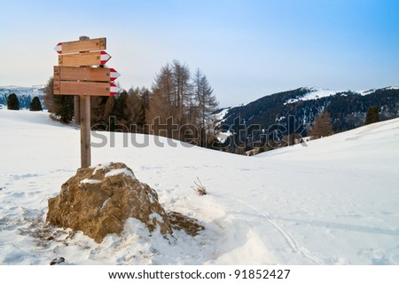 Trail mark path in winter time on snow landscape - stock photo