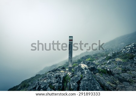 Trail marker showing the tenth stop in the mountains, scenic and mysterious environment. On the way to the top of Pico mountain in Azores islands, Portugal - stock photo
