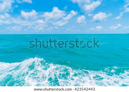 Trail on sea water surface behind  boat - stock photo