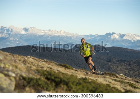 Trail running with a lot of fun in the Dolomites - stock photo