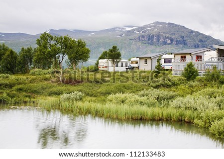 Trailer park with lake - stock photo