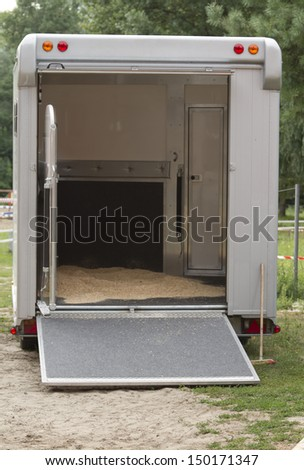Trailer van to transport horses before loading the horses. Rear view. - stock photo