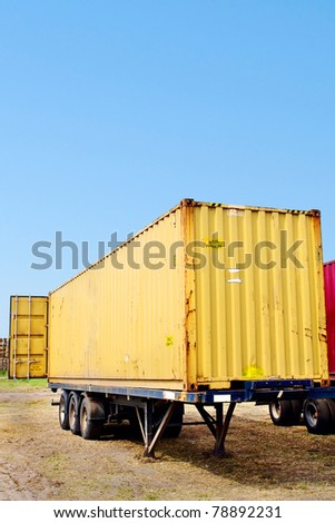 trailer with yellow container - stock photo