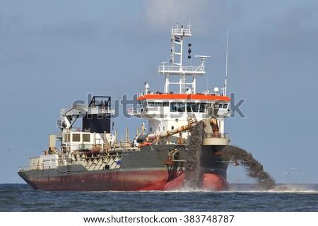 trailing suction hopper dredger creating land  - stock photo