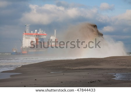 "Trailing suction hopper dredger (THSD) ""Utrecht"" Rain bowing - stock photo"