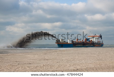 "Trailing Suction Hopper dredger ""Utrecht"" Rain-bowing sand on the beach - stock photo"