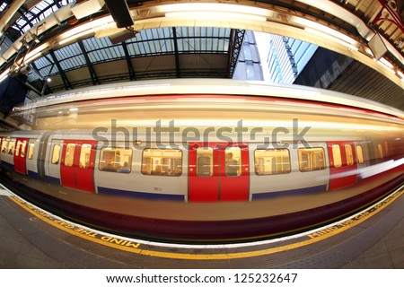 Train arriving at subway station in London, UK - stock photo