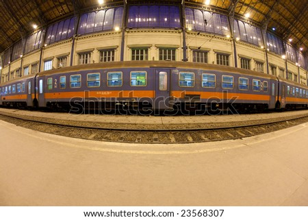 Train at station shot with fish-eye lens - stock photo