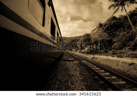 Train before Lam-pang in North Thailand on antique style - stock photo