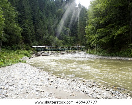 train by mountain river  - stock photo