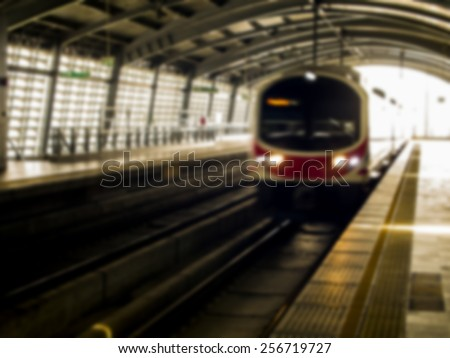 Train come the track at station in blur style - stock photo