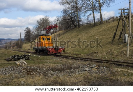 Train crane railcar. Hydraulic crane mounted on a railroad car (freight train)  - stock photo