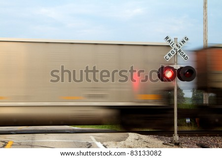 Train crossing in front of signal - stock photo