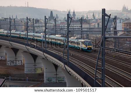 Train crossing the city at elevated railway - stock photo