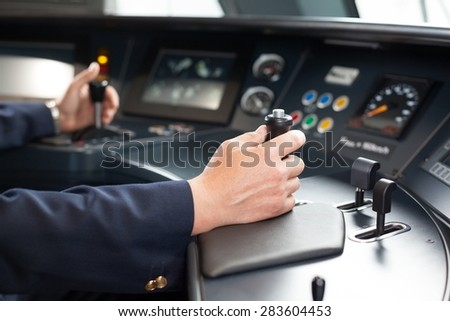 Train driver. Railroad engineer at the workplace. - stock photo
