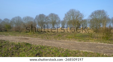 Train driving through nature in spring - stock photo