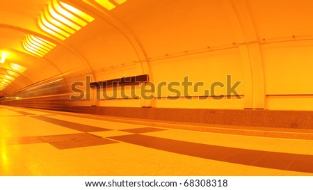 Train goes through the station - stock photo