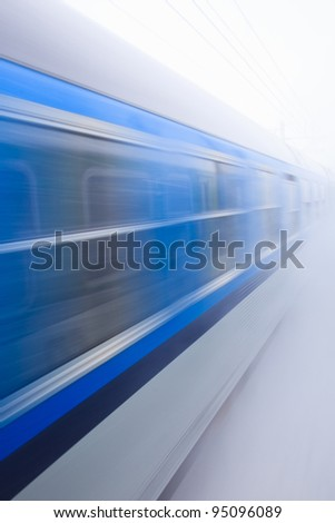 Train going fast in a snow storm - stock photo