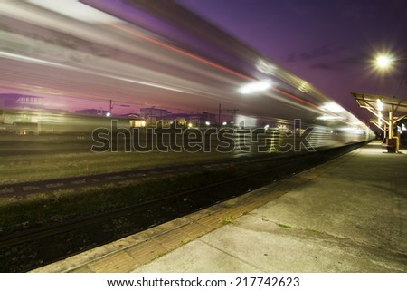 Train in motion  - light trail at night - stock photo