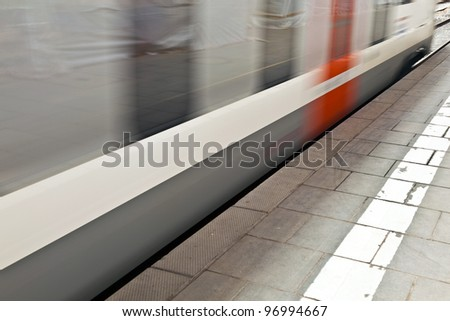 train in the station with speed - stock photo