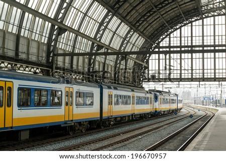 Train inside Amsterdam Central train station - stock photo
