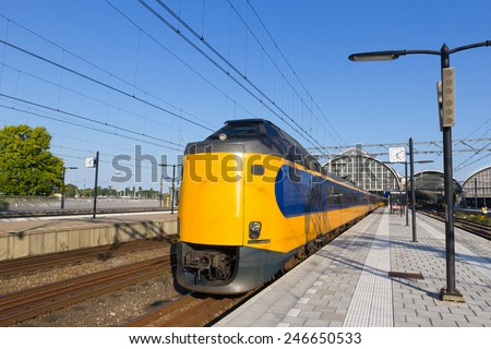 Train leaving Amsterdam Central Station. - stock photo