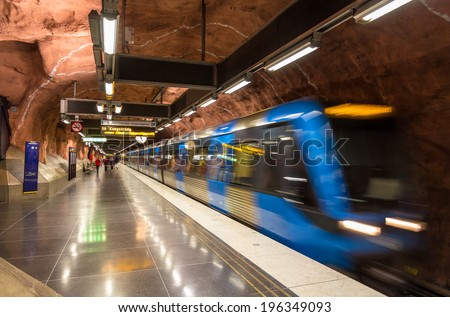 Train leaving Radhuset metro station in Stockholm - stock photo