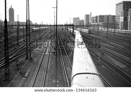 Train line crossing in black and white - stock photo