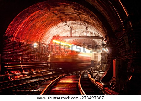 Train moving across tunnel - stock photo