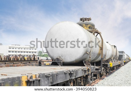 train of tanker cars transporting crude oil on the tracks. - stock photo