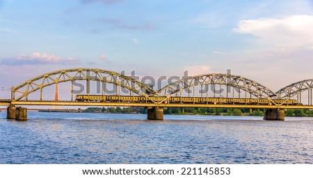 Train on a bridge in Riga, Latvia - stock photo