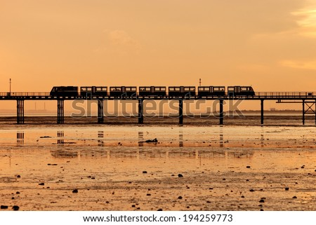 Train on the Southend Pier at sunset, Southend-on-Sea, Essex, England - stock photo
