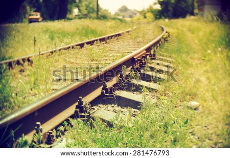 Train railroad disappearing in the distance. Soft focus. Retro style photo.  - stock photo