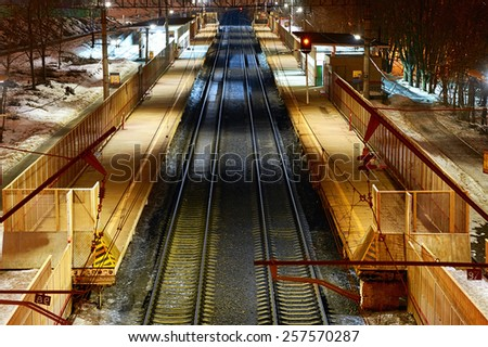 Train station at night from the top - stock photo