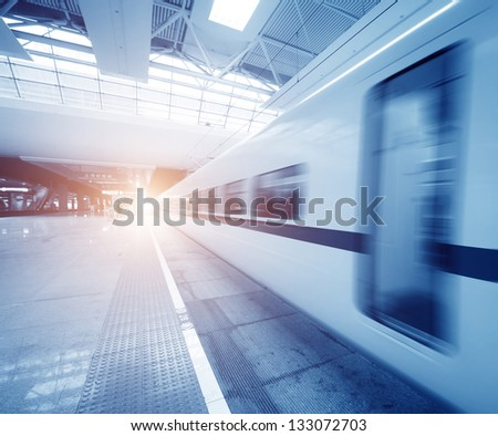 train stop at railway station - stock photo