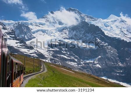 Train through the Swiss Alps - stock photo