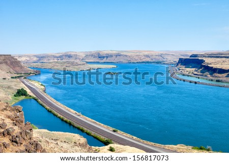 Train tracks and freeway along Columbia River. - stock photo