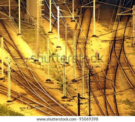 Train tracks in hongkong by night. - stock photo