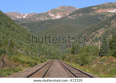 Train Tracks leading into the Rocky Mountains just east of Rollins Pass, Colorado - stock photo