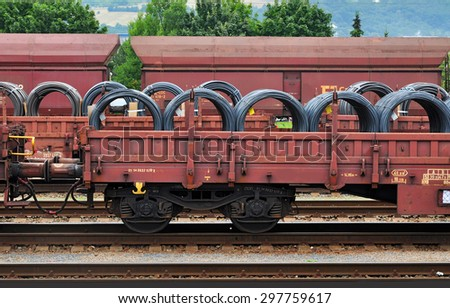 Train transit, rail transport of heavy cargo - stock photo