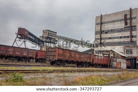 Train under loading of coal - stock photo