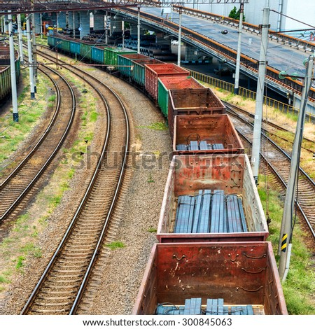 Train with cargo wagons on the railroad - stock photo