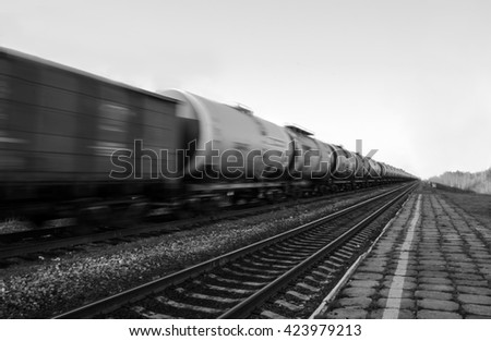 Train with oil tanks moving. Transportation of fuel on the railroad. Black and white shot. - stock photo